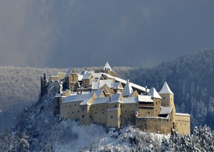 Rasnov Citadel In winter photo from air